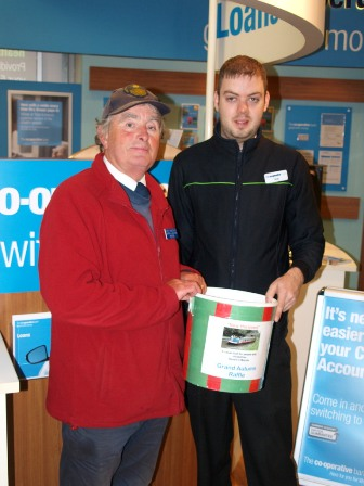 Drawing the raffle at Marple Co-op.